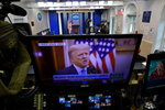 President Trump is seen on a network monitor after his pre-recorded farewell speech was released, inside the Brady Press Briefing Room at the White House, Tuesday, Jan. 19, 2021, in Washington. (AP Photo/Gerald Herbert)
