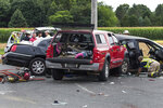 FILE - In this July 18, 2015 file photo authorities investigate the scene of a fatal crash between a limousine and a truck in Cutchogue, N.Y. Political leaders in New York have reached an agreement to pass new limousine safety bills inspired by deadly crashes in 2015 and 2018, officials said Tuesday, Jan. 14, 2020. (Randee Daddona/Newsday via AP, File)