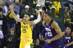 Baylor forward Tristan Clark, left, reacts to his basket while heading up court with TCU forward Jaedon LeDee, right, in the first half of an NCAA college basketball game, Saturday, Feb. 1, 2020, in Waco, Texas. (AP Photo/Rod Aydelotte)