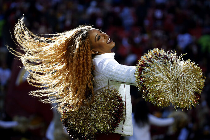 A Washington Redskins cheerleader perfrorms during the first half of an NFL football game against the Detroit Lions, Sunday, Nov. 24, 2019, in Landover, Md. (AP Photo/Alex Brandon)
