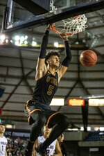 FILE - O'Dea's Paolo Banchero dunks against Mount Spokane in the fourth quarter during the 3A Boys State Basketball Championship at the Tacoma Dome, in Tacoma, Washington, in this Saturday, March 2, 2019, file photo. Banchero is the headliner in Duke's latest top-flight recruiting class, a 6-foot-10, 250-pound power forward widely regarded as a potential top NBA draft pick whenever he goes pro. He's also set to be the top threat for a Blue Devils team preparing for its final season under Hall of Famer Mike Krzyzewski. (Dean Rutz/The Seattle Times via AP, File)