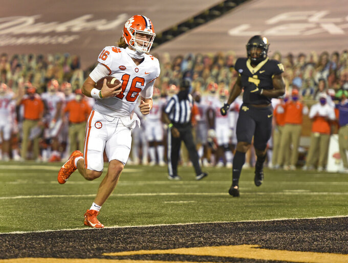Clemson quarterback Trevor Lawrence scores against Wake Forest during the first half of an NCAA college football game Saturday, Sept. 12, 2020, in Winston-Salem, N.C. (Walt Unks/The Winston-Salem Journal via AP)