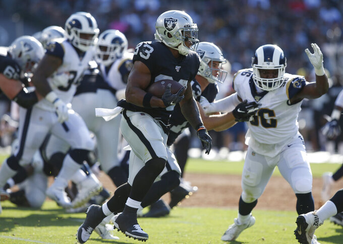 Oakland Raiders' DeAndre Washington (33) runs against the Los Angeles Rams during the first half of a preseason NFL football game Saturday, Aug. 10, 2019, in Oakland, Calif. (AP Photo/Rich Pedroncelli)