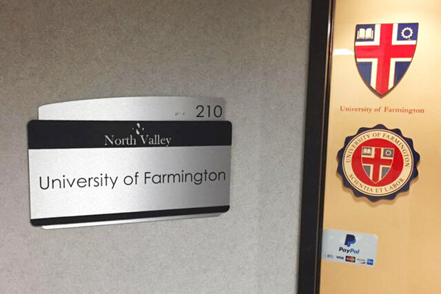 This 2017 handout photo provided by Matt Friedman shows an office for the University of Farmington in Farmington Hills, Mich. Federal authorities are defending the creation of a fake university in suburban Detroit and the arrests of 250 students amid a national debate over the sting operation. The government says the international students knew Farmington University was a sham and simply enrolled to stay in the U.S. (Matt Friedman via The AP)