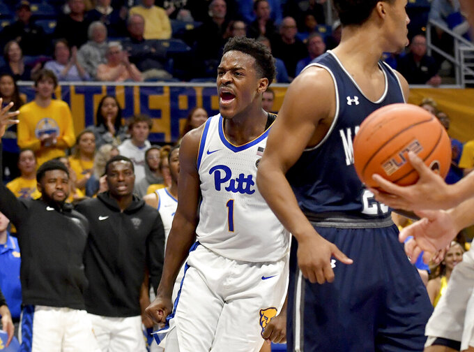 Pitt guard Xavier Johnson drives celebrates after drawing a foul against Monmouth in the second half of an NCAA college basketball game Monday, Nov. 18, 2019, in Pittsburgh, Pa. (Matt Freed/Pittsburgh Post-Gazette via AP)