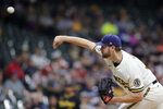Milwaukee Brewers' Adrian Houser pitches during the first inning of the team's baseball game against the Pittsburgh Pirates on Tuesday, Aug. 3, 2021, in Milwaukee. (AP Photo/Aaron Gash)