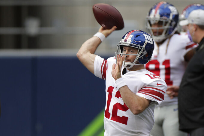 New York Giants quarterback Colt McCoy passes as he warms up before an NFL football game against the New York Giants, Sunday, Dec. 6, 2020, in Seattle. (AP Photo/Larry Maurer)