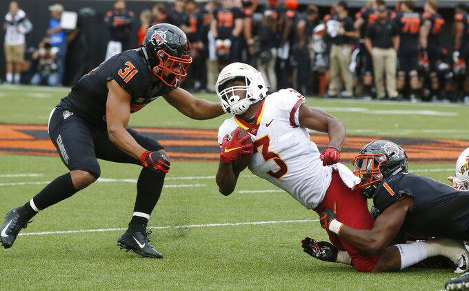 Iowa State running back Kene Nwangwu (3) is tackled by Oklahoma State safety Kolby Peel (31) and linebacker Calvin Bundage (1) in the second half of an NCAA college football game in Stillwater, Okla., Saturday, Oct. 6, 2018. (AP Photo/Sue Ogrocki)