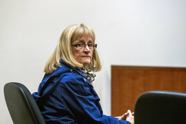 Barbara Chance, mother of Jared Chance, who was found guilty in the 2018 slaying and dismemberment of Ashley Young, appears at the Kent County Courthouse in Grand Rapids, Mich., on Monday, Jan. 6, 2020. She pleaded no contest to charges that she lied to police and helped her son cover up the murder of Young. (Cory Morse/The Grand Rapids Press via AP)