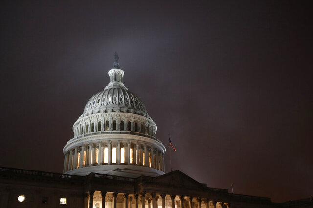 Mist rolls over the U.S. Capitol dome early Monday, Dec. 9, 2019, before a House Judiciary Committee hearing regarding the impeachment inquiry of President Donald Trump on Capitol Hill in Washington. (AP Photo/Patrick Semansky)