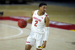 Maryland guard Aaron Wiggins works the floor against Nebraska during the second half of an NCAA college basketball game, Tuesday, Feb. 16, 2021, in College Park, Md. Maryland won 64-50. (AP Photo/Julio Cortez)