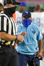 Citadel head coach Brent Thompson argues with an official after a penalty call during the second half of an NCAA college football game against South Florida Saturday, Sept. 12, 2020, in Tampa, Fla. (AP Photo/Chris O'Meara)