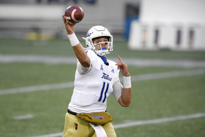 Tulsa quarterback Zach Smith (11) passes during the first half of an NCAA college football game against Navy, Saturday, Dec. 5, 2020, in Annapolis, Md. (AP Photo/Nick Wass)