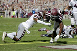 Texas A&M running back Isaiah Spiller (28) bounces off a tackle attempt from Mississippi State cornerback Jarrian Jones (2) as he crosses the goal line for a touchdown during the third quarter of an NCAA college football game, Saturday, Oct. 26, 2019, in College Station, Texas. (AP Photo/Sam Craft)