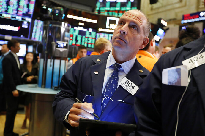 Trader Michael Urkonis works on the floor of the New York Stock Exchange, Friday, Sept. 13, 2019. Stocks are having a mixed performance early on Wall Street Friday as gains in banks and energy companies are offset somewhat by a drop in technology stocks. (AP Photo/Richard Drew)