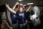 Los Angeles Dodgers pitcher Dustin May, center, is doused during a lockerroom celebration after the Dodgers defeated the Baltimore Orioles 7-3 in a baseball game Tuesday, Sept. 10, 2019, in Baltimore. The Dodgers clinched the NL West title. (AP Photo/Julio Cortez)