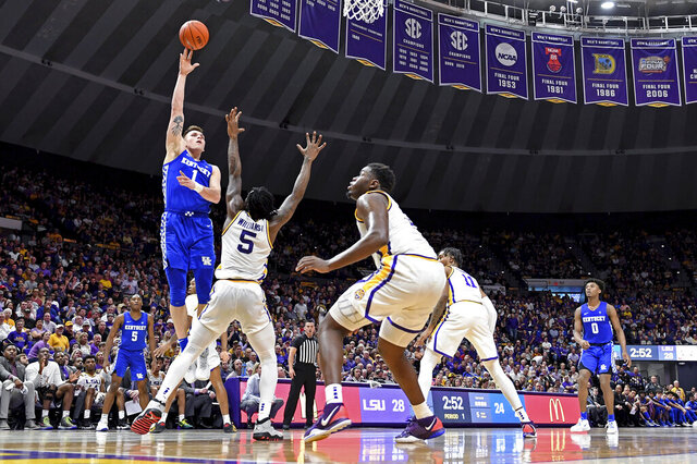 Kentucky forward Nate Sestina (1) shoots over LSU forward Emmitt Williams (5) as LSU forward Darius Days (0) watches during the first half of an NCAA college basketball game Tuesday, Feb. 18, 2020, in Baton Rouge, La. (AP Photo/Bill Feig)