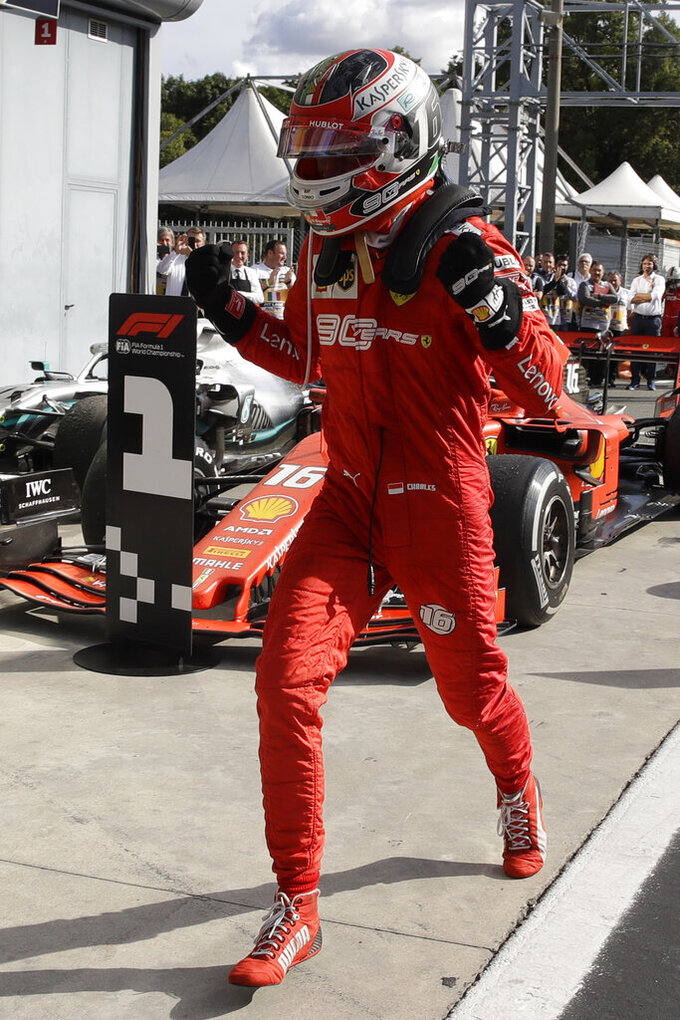 Ferrari driver Charles Leclerc of Monaco celebrates after winning the Formula One Italy Grand Prix at the Monza racetrack, in Monza, Italy, Sunday, Sept. 8, 2019. (AP Photo/Luca Bruno)