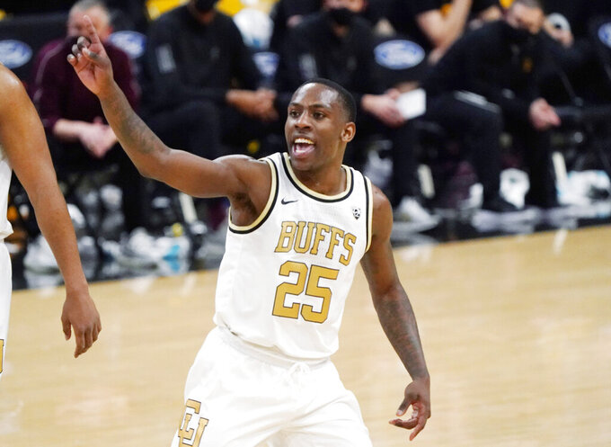 FILE - In this March 4, 2021, file photo, Colorado guard McKinley Wright IV gestures as time runs out in the second half of an NCAA college basketball game against Arizona State in Boulder, Colo. (AP Photo/David Zalubowski, File)
