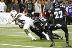 With no time left in the 4th quarter, Hawaii defensive back Kalen Hicks (3) and defensive lineman Manly Williams (49) tackle Arizona quarterback Khalil Tate (14) just short of the end zone during an NCAA college football game, Saturday, Aug. 24, 2019, in Honolulu. (AP Photo/Marco Garcia)