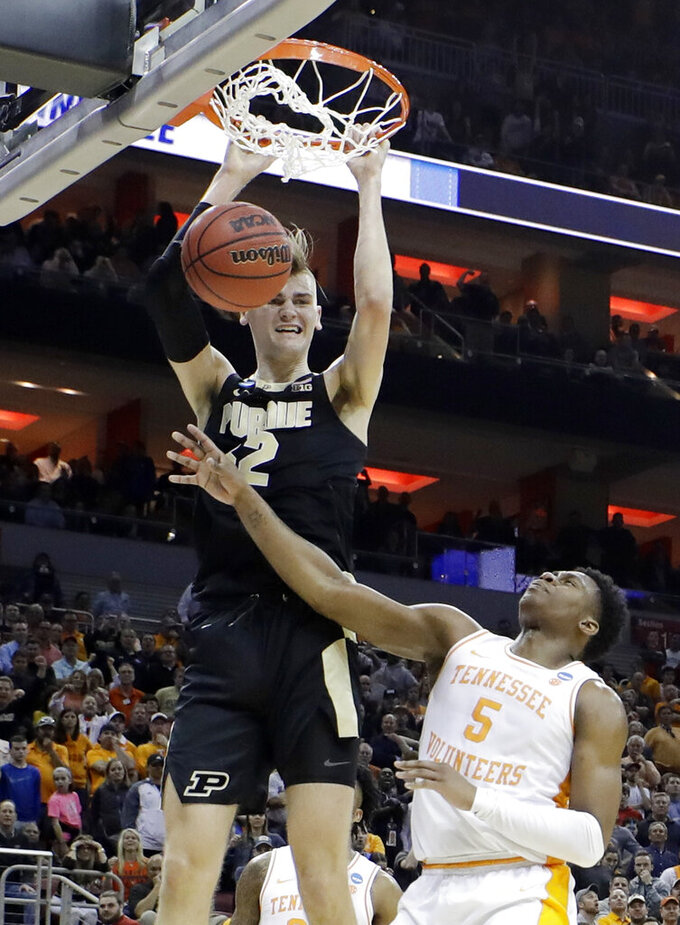 Purdue center Matt Haarms (32) scores over Tennessee guard Admiral Schofield (5) during overtime of a men's NCAA Tournament college basketball South Regional semifinal game Thursday, March 28, 2019, in Louisville, Ky. Purdue won 99-94. (AP Photo/Timothy D. Easley)