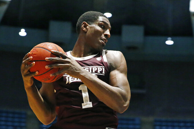 Mississippi State forward Reggie Perry (1) pulls down a rebound against New Mexico State during the second half of an NCAA college basketball game, Sunday, Dec. 22, 2019, in Jackson, Miss. (AP Photo/Rogelio V. Solis)