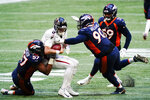 Denver Broncos' DeMarcus Walker (57) and defensive end DeShawn Williams (90) sack Atlanta Falcons quarterback Matt Ryan (2) during the second half of an NFL football game, Sunday, Nov. 8, 2020, in Atlanta. (AP Photo/Brynn Anderson)