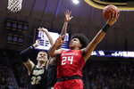 Rutgers guard Ron Harper Jr. (24) shoots over Purdue center Matt Haarms (32) during the first half of an NCAA college basketball game in West Lafayette, Ind., Saturday, March 7, 2020. (AP Photo/Michael Conroy)