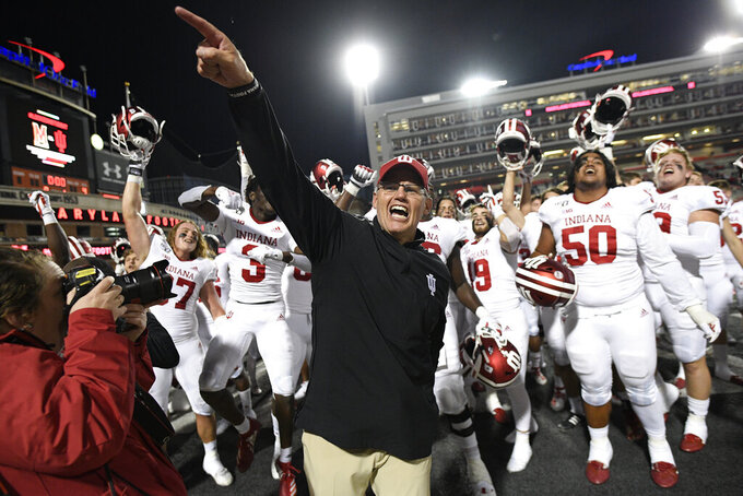 FILE - Indiana head coach Tom Allen, center, celebrates with his team after an NCAA college football game against Maryland in College Park, Md., in this Saturday, Oct. 19, 2019, file photo. Indiana coach Tom Allen has agreed to a restructured contract that will keep him with the Hoosiers through the 2027 season for $4.9 million in annual compensation.(AP Photo/Nick Wass, File)