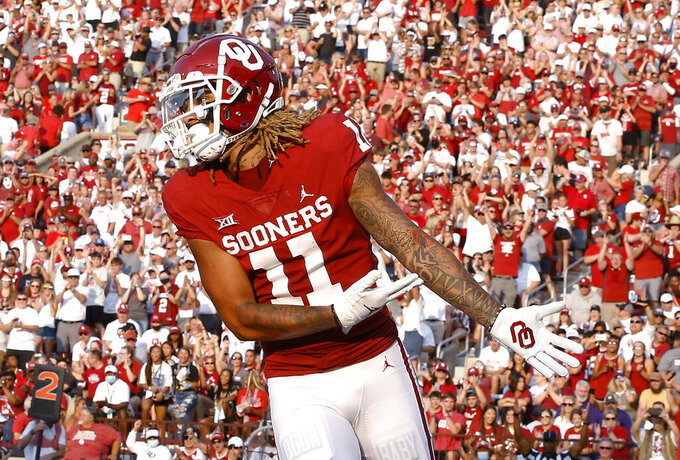 Oklahoma wide receiver Jadon Haselwood (11) celebrates after scoring a touchdown against Western Carolina during the first half of an NCAA college football game Saturday, Sept. 11, 2021, in Norman, Okla. (AP Photo/Alonzo Adams)