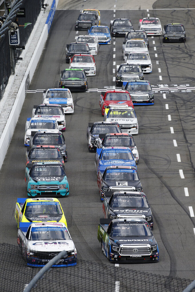 Brett Moffitt, left, and Christian Eckes, right, lead the field at the start of the NASCAR Truck Series race at Martinsville Speedway in Martinsville, Va., Saturday, Oct. 26, 2019, (AP Photo/SteveHelber)