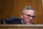 "FILE - In this Feb. 4, 2021, file photo Sen. Richard Burr, R-N.C., listens during a Senate Health, Education, Labor and Pensions Committee hearing on the nomination Boston Mayor Marty Walsh to be labor secretary on Capitol Hill. When Burr stood and said ""guilty"" there were hushed gasps in the Senate chamber. But the North Carolina Republican's vote to convict former President Donald Trump should not have come as a shock. (Graeme Jennings/Pool via AP, File)"