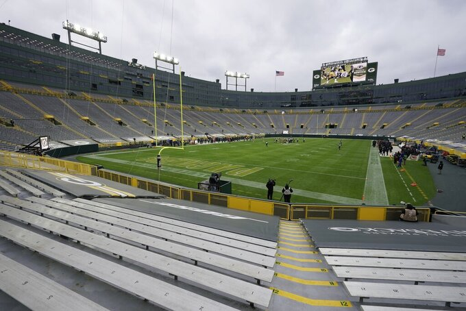 The seats at Lambeau Field are empty during the first half of an NFL football game between the Green Bay Packers and the Jacksonville Jaguars Sunday, Nov. 15, 2020, in Green Bay, Wis. (AP Photo/Morry Gash)