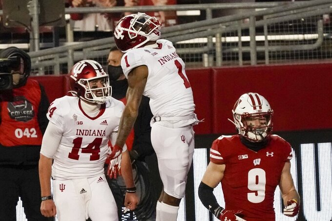 Indiana's Whop Philyor celebrates his touchdown catch with quarterback Jack Tuttle during the second half of an NCAA college football game against Wisconsin Saturday, Dec. 5, 2020, in Madison, Wis. (AP Photo/Morry Gash)