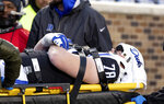 Duke's Casey Holman (78) is wheeled off the field on a stretcher after suffering an injury in the first half of an NCAA college football game against Syracuse in Durham, N.C., Saturday, Nov. 16, 2019. (AP Photo/Ben McKeown)