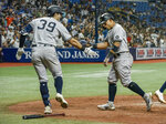 New York Yankees on-deck batter Ryan LaMarre (39) congratulates Rougned Odor, who scored on Gio Urshela's two-run double against the Tampa Bay Rays during the fifth inning of a baseball game Tuesday, July 27, 2021, in St. Petersburg, Fla. (AP Photo/Steve Nesius)
