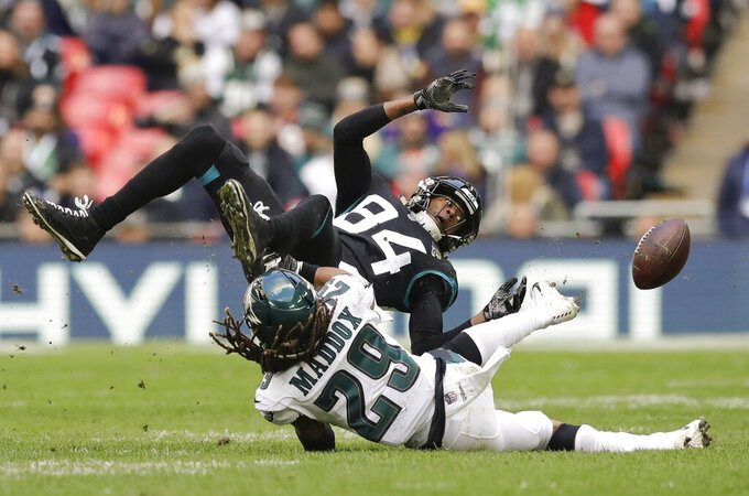 FILE - In this Oct. 28, 2018, file photo, Jacksonville Jaguars wide receiver Keelan Cole (84) is tackled by Philadelphia Eagles free safety Avonte Maddox (29) during the first half of an NFL football game, at Wembley stadium in London. When injuries ravaged the secondary, the Philadelphia Eagles turned to inexperienced guys and castoffs. The no-names are making themselves known. (AP Photo/Matt Dunham, File)