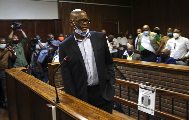 African National Congress secretary general Ace Magashule appears for a bail hearing inside the magistrates court in Bloemfontein, South Africa, Friday, Nov. 13, 2020. Magashule is charged in connection with the looting of $13.8 million when he was premier of the Free State province from 2009 until 2018. (AP Photo)