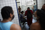 Locals vote at a polling station during the run-off municipal elections in Rio de Janeiro, Brazil, Sunday, Nov. 29, 2020. (AP Photo/Silvia Izquierdo)