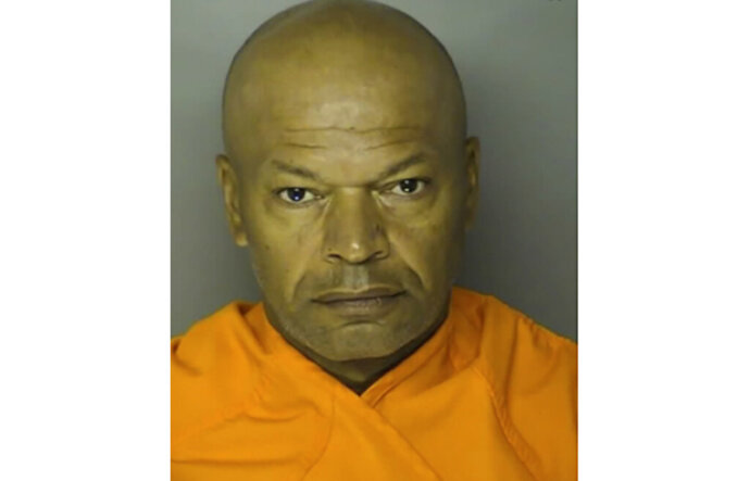 "This booking photo provided by Horry County shows Giles Daniel Warrick.   Warrick accused in a series of rapes on the East Coast in the 1990s that led to the suspect being nicknamed the ""Potomac River Rapist"" has been arrested in South Carolina.  Warrick is being held without bond in a Horry County jail. He's accused of raping 10 women and killing one of them between 1991 and 1998. (Horry County via AP)"