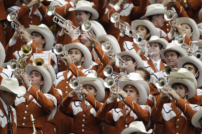 FILE - In this Saturday, Sept. 4, 2010 file photo, Members of the University of Texas Longhorn Band perform during the NCAA football game against Rice in Houston. Texas announced Wednesday, May 19, 2021, the hiring of Cliff Croomes, assistant director of bands at LSU, who will take over the Longhorn Band starting June 1. He replaces Scott Hanna, who had been in the role since 2015. Croomes is the 15th director of the band that was founded in 1900.(AP Photo/Pat Sullivan, File)
