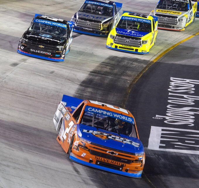 Sheldon Creed leads the field into Turn 3 during the NASCAR Truck Series auto race Thursday, Sept. 16, 2021, at Bristol Motor Speedway in Bristol, Tenn. (David Crigger/Bristol Herald Courier via AP)