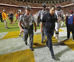 South Carolina head coach Will Muschamp leaves the field after their 41-21 loss to Tennessee in an NCAA college football game Saturday, Oct. 26, 2019, in Knoxville, Tenn. (AP Photo/Wade Payne)