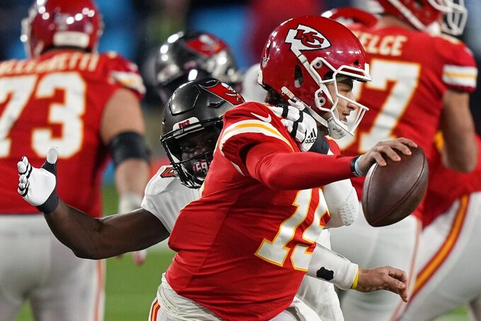 Kansas City Chiefs quarterback Patrick Mahomes passes under pressure from Tampa Bay Buccaneers outside linebacker Shaquil Barrett during the first half of the NFL Super Bowl 55 football game Sunday, Feb. 7, 2021, in Tampa, Fla. (AP Photo/David J. Phillip)