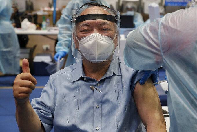An elderly man flashes the thumbs up sign as he is inoculated with Russia's Sputnik V COVID-19 vaccine inside the Makati Coliseum in Manila, Philippines on Tuesday, May 4, 2021. The Philippines started a simultaneous vaccination of the initial 15,000 doses of Russia's Sputnik V COVID-19 vaccines that arrived in the country earlier this week. (AP Photo/Aaron Favila)