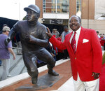 FILE - In this Saturday, Sept. 7, 2013, file photo, Hall of Fame second baseman Joe Morgan poses with his statue that was unveiled at Great American Ball Park, in Cincinnati. Joe Morgan has died. A family spokesman says he died at his home Sunday, Oct. 11, 2020, in Danville, Calif.(AP Photo/David Kohl, File)