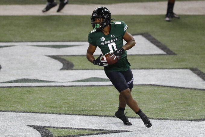 Hawaii running back Dae Dae Hunter turns after scoring a touchdown against UNLV during the first half of an NCAA college football game Saturday, Dec. 12, 2020, in Honolulu. (AP Photo/Marco Garcia)