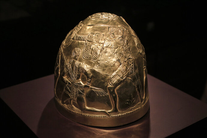 FILE - In this Friday April 4, 2014 file photo, a Scythian gold helmet from the fourth century B.C. is displayed as part of the exhibit called The Crimea - Gold and Secrets of the Black Sea, at Allard Pierson historical museum in Amsterdam. An appeals court in Amsterdam says it needs more time to rule on the ownership of a valuable trove of historical artefacts loaned to a Dutch museum by four museums in Crimea shortly before the region's 2014 annexation by Russia. In an interim ruling on Tuesday, July 16, 2019, the Amsterdam Court of Appeal says it needs