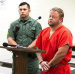 Michael W. Jones Jr. grimaces during his initial appearance at the Marion County Jail courtroom, Thursday, Sept. 19, 2019, in Ocala, Fla. Jones, suspected of killing his wife and four children and driving their bodies into Georgia, returned to Florida to face murder charges. (Doug Engle/Star-Banner via AP)