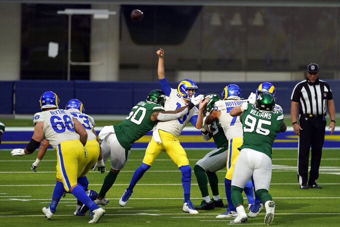 Los Angeles Rams quarterback Jared Goff throws under pressure from New York Jets linebacker Frankie Luvu (50) during the first half of an NFL football game Sunday, Dec. 20, 2020, in Inglewood, Calif. (AP Photo/Ashley Landis)